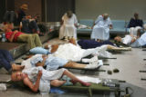 (NYT19) NEW ORLEANS -- Sept. 2, 2005 -- KATRINA-EVACUATE-5 -- Hundreds of elderly evacuees lay...