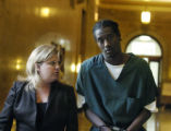 Denver, CO Sept. 2, 2005 Christopher Baldwin is escorted out of court with his defense attorney,...