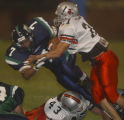 ThunderRidge running back, Mike Coffey,left  #7, gets taken down by Loveland linebacker, Nicholas...