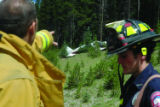 Summit Daily/Kristin Skvorc Vail firefighters Charles Vona, left, and Eric Morrell look at the...