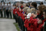 Courtney Donaldson, 36, a member of the Winter Park Ski Patrol cries as she waits for the casket...