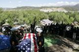 Marines carry the casket of Lance Corporal Evenor Herrera to his gravesite during his funeral at...