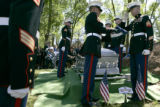 Marines prepare to present the United States flag to the parents of fallen Marine Lance Corporal...