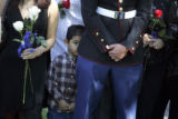 Joshua Sanchez, cq, 4, peers from behind his uncle, Lance Corporal Balmore Herrera, cq, during a...