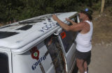 "Woody Creek local, Andy Hall (cq), 64, adds more memories to his ""Gonzo"" style van by..."