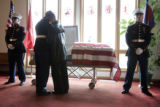 Lance Corporal Balmore Herrera, cq, left, consoles his cousin Zachariel Herrera, cq, as they visit...