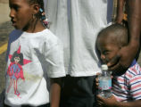 Betty Ann Matthews, cq, 7, left, and brother Tahj Sweeting, 4, cq, right, stand close to their...