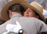 Rocky Mountain National Park Ranger Maria Elena Sebastian, right, is comforted by a fellow ranger...