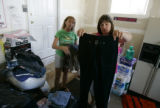 Angela Coonce, cq, right, looks at a pair of pants as her sister-in-law, Denise Parker, of Bay St....