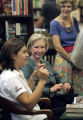 (l) Toyota Atlantic driver Katherine Legge (cq) signed books with former driver (m) Janet Guthrie...