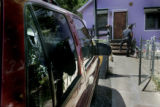 Denver  Police investigate a home Monday August 22, 2005 , whose car was shot up during a drive...