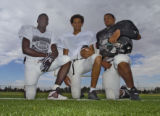 Montbello football players Andrew Davis (wide receiver), Chris Smith (QB) and Gregg Banks...