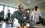 Hurricane Katrina evacuee Jacques Garnett (cq, center), 39, of New Orleans blows out the candles...