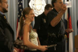 Recipient Megan MacDonnell, center, laughs while Denver police Chief Gerry Whitman shows the...