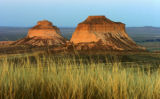 The Pawnee Buttes are 350 feet above the plains of the grassland and are a half mile apart. They...