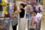 Brittany Pinnell (cq),14,left, mother Lisa Markey,center, and daughter, Aliana...
