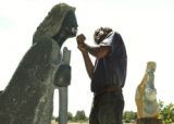 Loveland, CO Aug. 25, 2005 Stalin Tafura, 24, from Zimbabwe, repairs a scuplture that was damaged...