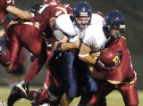 Castle Rock, CO Aug. 26, 2005  Jordan Baum of Columbine plows into Kellen Zanandrie (cq) of...