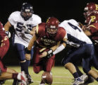 Castle Rock, CO Aug. 26, 2005  Ponderosa quarterback Nick Rossetti, (5) fumbles during a 3rd...