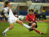 (Heraklion, Crete  on Weds, Aug. 11, 2004- United States forward Mia Hamm, #9, scores a goal past...