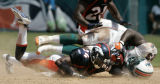Champ Bailey is injured after tackling Ronnie Brown in the second half of the Denver Broncos...