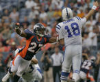 Denver Broncos Darrent Williams, #27, launches himself at Indianapolis Colts quarterback Peyton...