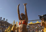 Former University of Colorado volleyball standout, Rachell Wacholder waves to her fans after...