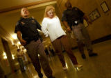 Sandi Healey is escorted from Denver County court room 12 after being  sentenced on Thursday...
