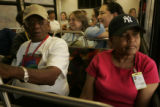 Displaced Huricane victims Alfred Taylor (cq) left, and Joyce Lockett (cq) right, ride on a bus to...