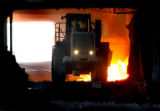 (Pueblo, Colo., April 21, 2004)  Red hot slag is moved by a tractor in the production plant at...
