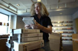 Denver Public Library Volunteer Joanne Weiss (CQ), of Denver, unpacked and shelved some of the...