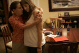 Julie Moyer, cq, left, hugs her friend Catherine Cathey, cq, whose husband, Second Lt. James...