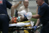 West Metro Fire Rescue workers try to revive a woman who was retrieved from a swimming pool at the...