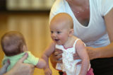 Jessica Read (cq), right,  holds her four month old baby Chamber Rohlfs, center, to visit with...