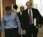 Todd Stansfield, Jr., 17, left, walks out of a Douglas County courtroom with his attorney, Forrest...