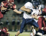 Castle Rock, CO Aug. 26, 2005  Columbine quarterback, John Fink, gains yards in the fourth quarter...