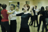 Denver, CO Sept. 2, 2005 Dance instructor Jennifer Corey teaches the Tango to newbies and veterans...