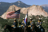 The mounted Honor Guard from Fort Carson stands at attention at a citizenship ceremony at the...