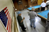 (Pueblo, Colo., April 21, 2004)  Retired steelworkers play cards and pool together at the union...