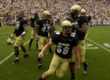 University of Colorado player, Gregory Pace, front #58, leads his team in celebrating winning the ...