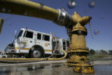 A pumper stands by at the Denver Fire Academy during drills Wednesday August 31, 2005.The Denver...