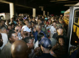 (NYT4) NEW ORLEANS, La. -- Aug. 31, 2005 -- KATRINA-EVACUATE -- A large crowd of New Orleans...