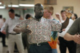 Denver, CO Sept. 2, 2005 Irvin Jones of Aurora  practices his moves during a tango  class. Newbies...