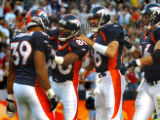 (DENVER., NOVEMBER 7, 2004)  Denver Broncos' #39, Kyle Johnson, left, is congradulated by #80, Rod...