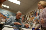 Pete Coors, along with his daughter-in-law, Meredith, takes some time to help address post cards...