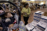 Longmont, Co.,  October 28, 2004.   Season to Share.   Micaela Martinez shops for groceries as her...