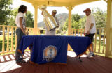 (PALMER LAKE, Colo.,  8/13/04  2004 ) Kayla,15, her dad, Eric Lawson placing the cup on the table,...
