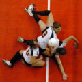 (DENVER, CO., NOVEMBER 12, 2004)  Fort Morgan's #10, Madeline Rebol, #3, Chandra Ginest and #6,...