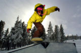 (BRECKENRIDGE, Co., SHOT 11/12/2004) Wyatt Glynn, 22, of Breckenridge rides a step-down box Friday...