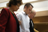(11/12/2004 Castle Rock, Colorado) Todd Stansfield, 16, center, leaves a Douglas County courtroom...